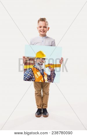 little smiling boy pretending to be workman, isolated on white poster