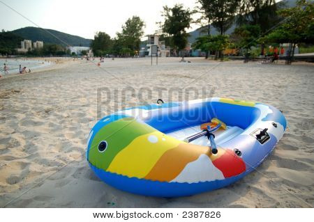 A colorful pneumatic boat on beach