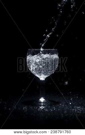 Pouring Water Into A Glass.