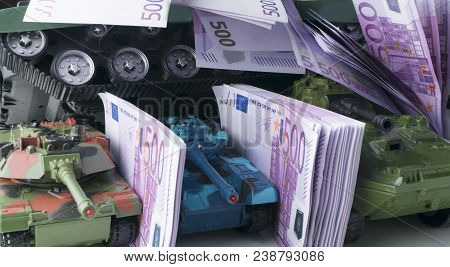 Close Up Green And Blue Tank Toy Placed On Euro Banknotes Pile. Business And Economy War. New World