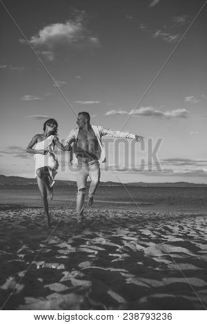 Sensual Couple. Man And Woman Hold Hands, Couple Happy On Vacation. Couple In Love Stand On Beach, S