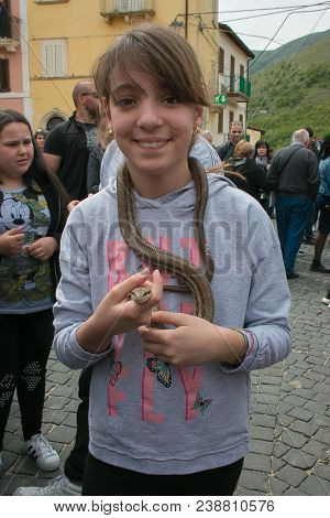 Cocullo, Italy - May 1, 2018: Happy Beautiful Child With Snake In Cocullo For The Serpari Feast, Abr
