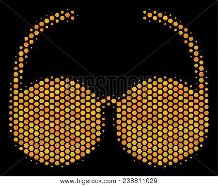 Halftone Hexagon Spectacles Icon. Bright Gold Pictogram With Honey Comb Geometric Pattern On A Black