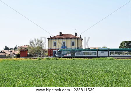 The Arrival Of The Train In A Small Railway Station Of A Lombard Village Located In The Countryside