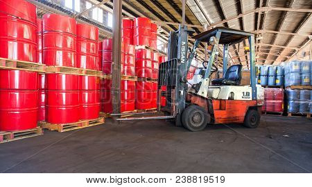 Johannesburg, South Africa, March 25 - 2015: Fork Lift Truck In A Warehouse Full Of Barrels.
