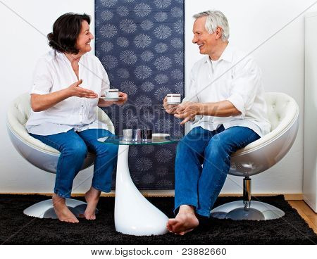 sweet senior couple in love drinking coffee