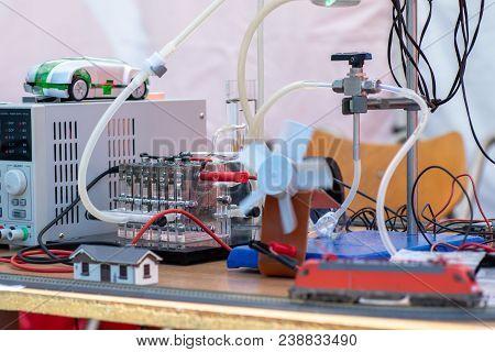 Hydrogen Fuel Cells Experiment. Hydrogen (h2) Cells Powering Model Train Locomotive, Light Diodes An
