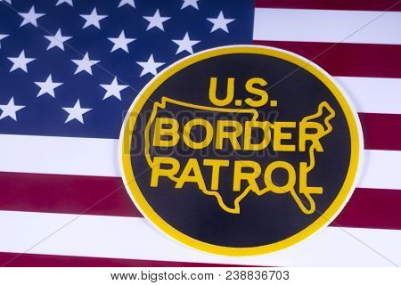 London, Uk - March 18th 2018: The Symbol Of The Us Border Patrol Pictured Over The Usa Flag, On 18th