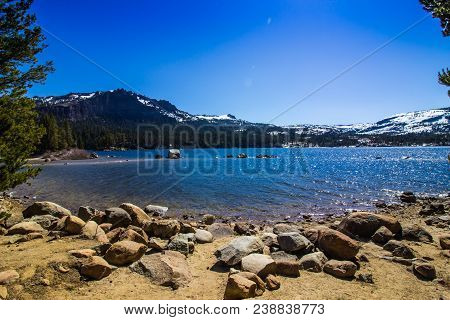 Mountain Lake Shoreline With Boulders & Shallow Waters
