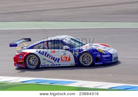 ESTORIL - SEPTEMBER 25: The Porsche 997 GT3 RSR of the team IMSA Performance Matmut piloted by Raymond Narac in the LMS race