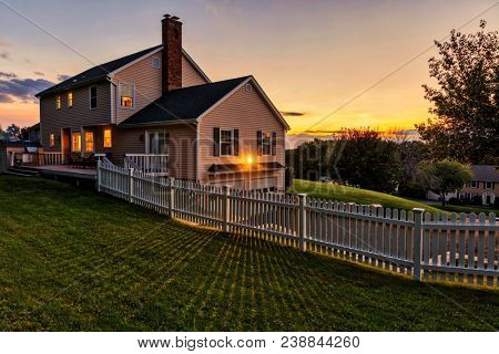 Beautiful colonial American house at sunset