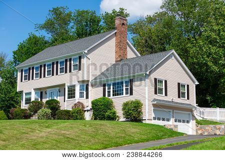 American traditional Colonial house front view in summer