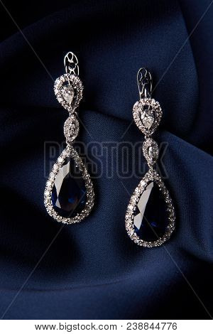 Two Golden Sapphire Earrings With Small Diamonds. Pair Of Platinum Earring With Sapphire Gemstone On