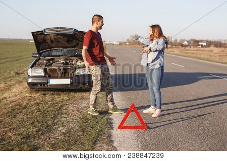 Couple Argue On Road, Have Problem With Brocken Car, Being In Panic, Don`t Know What To Do, Red Warn