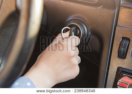 Woman`s Hand On Car`s Key, Tries To Start Engine, Turn On Key In Keyhole, Auto`s Panel And Wheel In