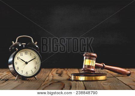 Judges Hammer With Alarm Clock On Black Board Background, Justice Concept