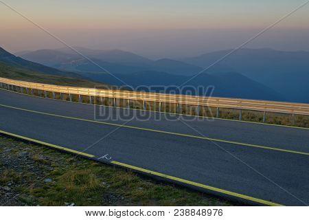 Dimming Over Mountain Highway Transalpina Through Paring Mts., Central Carpathians, Romania.