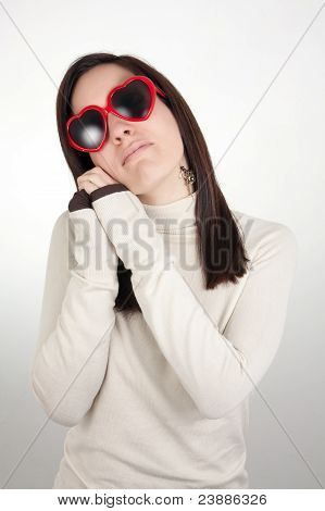 Dreamy Girl Wearing Heart-shaped Sunglasses