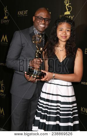 LOS ANGELES - APR 29:  Wayne Brady, Maile Masako Brady at the 45th Daytime Emmy Awards at the Pasadena Civic Auditorium on April 29, 2018 in Pasadena, CA