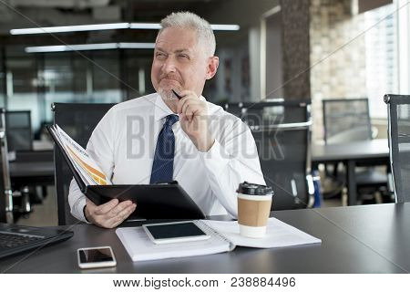 Content Business Leader Thinking Over Investment Plan And Profit. Mature Man In Tie With Satisfied A