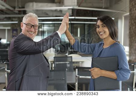 Two Happy Business Colleagues Giving High Five After Successful Project Start. Smiling Mature Man An