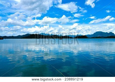 Beautiful View Of Khao Sok National Park In Thailand. Blue Body Of Water Under Cloudy Sky At Daytime