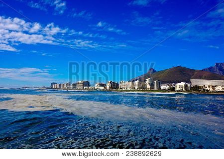 White High Rise Buildings Near Sea At Daytime. Cape Town.