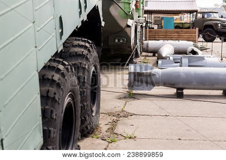 Military Base With Weapons And Heavy Machinery.  Army Naval Post With Air Boms Outdoors. Cold War An