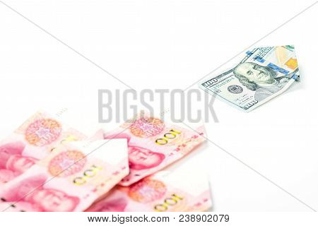Leadership And Different Concept With One Hundred Us Dollar Bill Leading One Hundred Chinese Yuan Bi