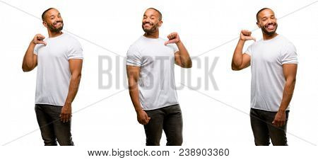 African american man with beard proud, excited and arrogant, pointing with victory face