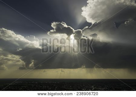 Beautiful Landscape With Sun Rays Through Clouds. Landscape With Clouds Over Small Town. Sun Rays Th