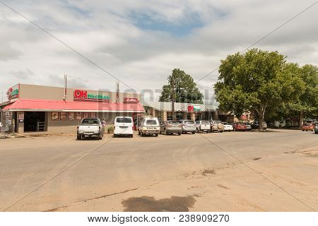 Winterton, South Africa - March 18, 2018: A Street Scene With A Supermarket, Liquor Store, Vehicles