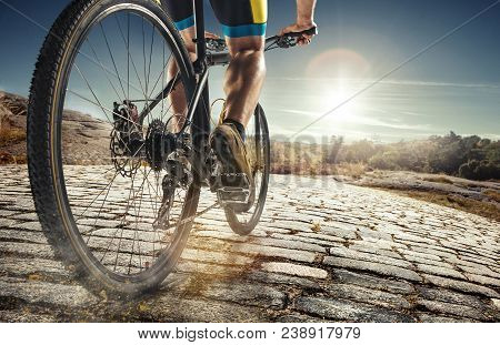 Detail Of Cyclist Man Feet Riding Mountain Bike On Outdoor Trail On Country Road In The Daytime. Bri
