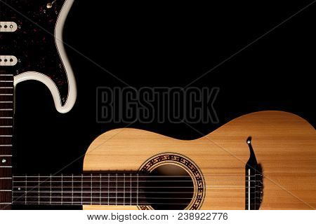 Guitars Music Image With Copy-space. Crossed Electric And Acoustic Guitar Corner Graphic Against Bla
