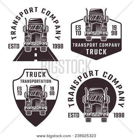 Truck Set Of Four Black Vector Emblems, Labels Or Logos For Transport Company Isolated On White Back