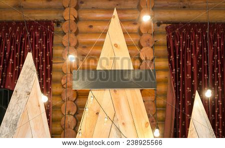 Design, Celebration, Feast Concept. On The Top Of The Light Wooden Construction Composed Of Three Pa