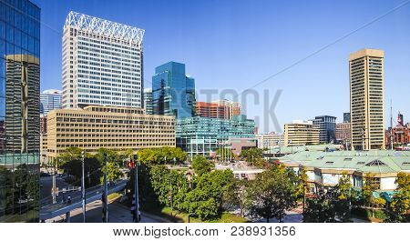 Baltimore - November 7; Baltimore Downtown With City Center Business Buildings During Sunny Day On N