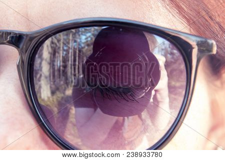 Lens Of The Camera With A Blend Which Is Photographed By A Young Guy Is Reflected In Sunglasses Put