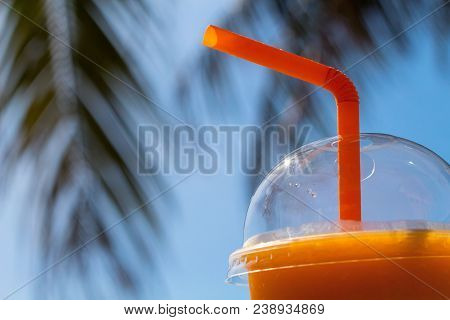 Mango Shake And Palm Branches. Yellow Mango Juice In Transparent Plastic Cup. Tropical Beach Drink.