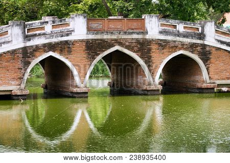 Old Pedestrian Bridge Over A River In The Historic City Ayutthaya, Thailand