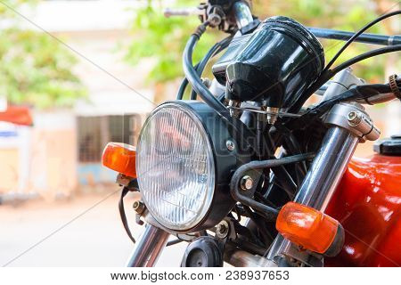 Front Light Of Old Motorbike. Vintage Motorcycle Closeup. Red And White Lights Of Retro Vehicle. Asi