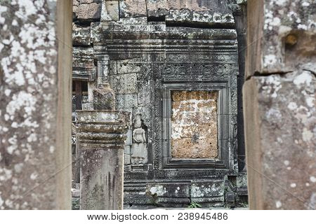 Stone Bas-relief In Angkor Temple, Siem Reap, Cambodia. Historical Site Of Khmer Architecture. Archa