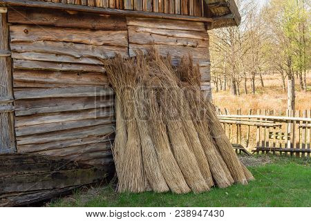 Kluki, Poland - April 29, 2018: Straw Bundles Near Old Woooden House In Museum Of The Kluki Village