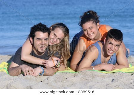 Happy Teen Couples On Beach Vacation