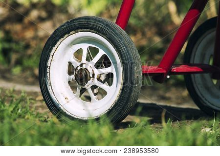 Rear Wheel Of Tricycle. Part Of The Children's Three-wheeled Bicycle Of The Ussr 80S