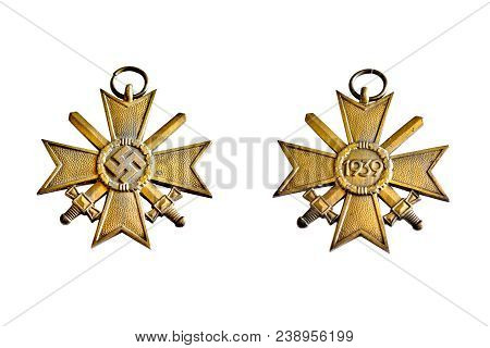 An old World War 2 Nazi Merit Medallion, circa 1939. Isolated on white background with both sides shown in one composite image. My brother acquired this at a German Flea market while stationed in the military many years ago. Submitted as a historical arti poster