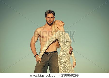 Relationship, Heterosexual, Relationship And Lifestyle Concept. Couple In Love On Blue Sky. Woman Or