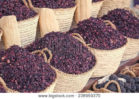 Hibiscus Dry Herb In Baskets. Natural Organic Herbs. Hibiscus Lilac Flowers In Baskets. Condiment An