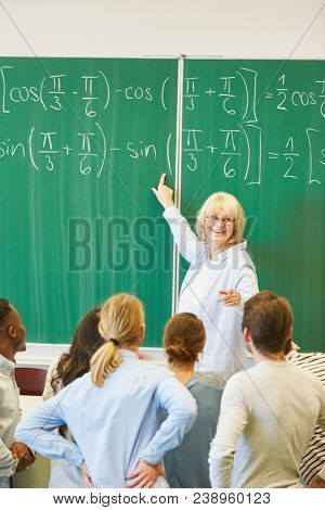 Lecturer teaches math to students and solve formula