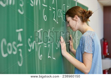 Frustrated woman as student calculating math problem with anger